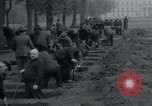 Image of German civilians bury Wobbelin victims Ludwigslust Germany, 1945, second 37 stock footage video 65675073877