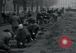 Image of German civilians bury Wobbelin victims Ludwigslust Germany, 1945, second 38 stock footage video 65675073877
