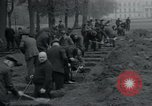Image of German civilians bury Wobbelin victims Ludwigslust Germany, 1945, second 41 stock footage video 65675073877