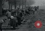 Image of German civilians bury Wobbelin victims Ludwigslust Germany, 1945, second 42 stock footage video 65675073877