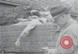 Image of piles of dead bodies Weimar Germany, 1945, second 48 stock footage video 65675073892