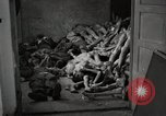 Image of pile of emaciated corpses Germany, 1945, second 18 stock footage video 65675073907