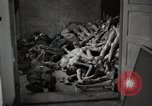 Image of pile of emaciated corpses Germany, 1945, second 19 stock footage video 65675073907