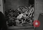 Image of pile of emaciated corpses Germany, 1945, second 24 stock footage video 65675073907