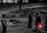 Image of unburied bodies of victims Germany, 1945, second 3 stock footage video 65675073912
