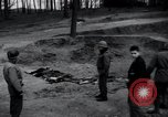 Image of unburied bodies of victims Germany, 1945, second 6 stock footage video 65675073912