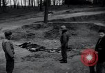 Image of unburied bodies of victims Germany, 1945, second 7 stock footage video 65675073912