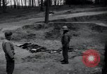 Image of unburied bodies of victims Germany, 1945, second 8 stock footage video 65675073912