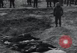 Image of unburied bodies of victims Germany, 1945, second 27 stock footage video 65675073912