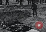 Image of unburied bodies of victims Germany, 1945, second 28 stock footage video 65675073912