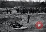 Image of unburied bodies of victims Germany, 1945, second 46 stock footage video 65675073912