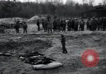 Image of unburied bodies of victims Germany, 1945, second 49 stock footage video 65675073912