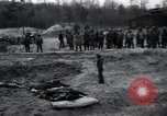 Image of unburied bodies of victims Germany, 1945, second 50 stock footage video 65675073912