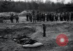 Image of unburied bodies of victims Germany, 1945, second 51 stock footage video 65675073912