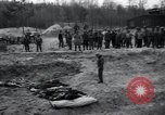 Image of unburied bodies of victims Germany, 1945, second 52 stock footage video 65675073912