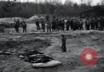 Image of unburied bodies of victims Germany, 1945, second 53 stock footage video 65675073912
