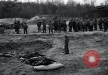 Image of unburied bodies of victims Germany, 1945, second 57 stock footage video 65675073912