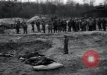 Image of unburied bodies of victims Germany, 1945, second 61 stock footage video 65675073912