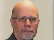 Mark L. Priest