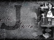 CARLOS J. MARIN
