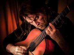 Billy Stewart playing acoustic guitar