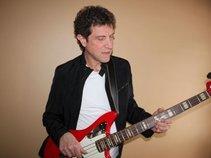 John K Bass