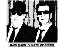 Two Guys In Suits And Ties