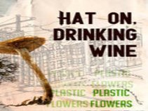 Hat on, Drinking Wine
