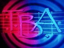 T.B.A.