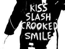 Kiss Slash Crooked Smile