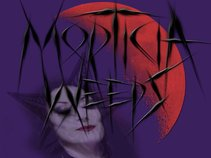 MORTICIA WEEPS
