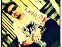 Kurtis B.