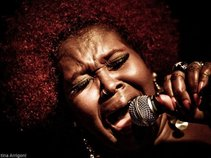 MS. SILKY SOL - THE RED AFRO QUEEN