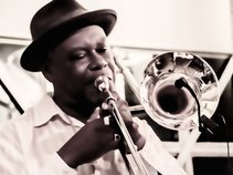 Neville 'MacDaddy' Anderson / Brass Rootz International
