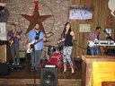 Natalie performing with her band Suo at Brother Jimmy's in Merry Brickell, Miami.