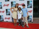 Roxanna posing on the red carpet with young rapper, Dai Dizzle, and her brother, JohnColeman.
