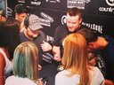 Psycho Billy Cadillac and DJSun at the CMAFest2014 signing autographs at the Rebel Core booth