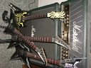 A beater gtr,jacksons and dean razorback with their big daddy Marshall Mode 4